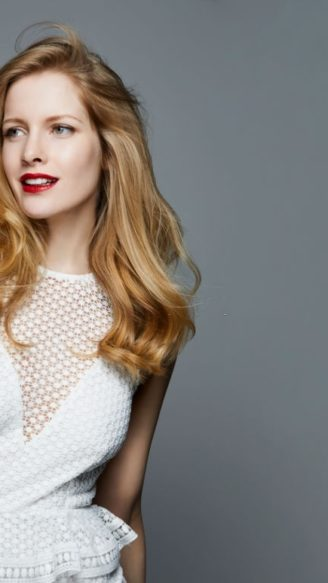 studio shot of a beautiful woman in a white cocktail dress and red lipstick, professionel hair and make-up