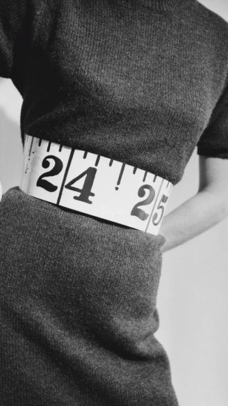 A fashion model wearing short sleeves wool dress with tape measure belt, UK, 23rd January 1967. (Photo by Mike McKeown/Daily Express/Hulton Archive/Getty Images)