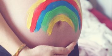 Maternity/Pregnancy shot showing a colorful painted baby bump.