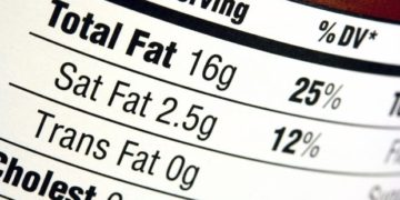 A nutrition label with a high fat content.  Very shallow depth of field.  Focus on the bold word Fat.
