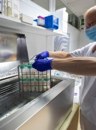 Laboratory Technician Sergio Cabeza puts bottles with donated breast milk into hot water at the Breast Milk Bank of the Balearic Islands' Banc de Sang i Teixits (tissues and boold bank) in Palma de Mallorca on May 14, 2021. (Photo by JAIME REINA / AFP) (Photo by JAIME REINA/AFP via Getty Images)