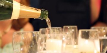 serving champagne at a cocktail party.