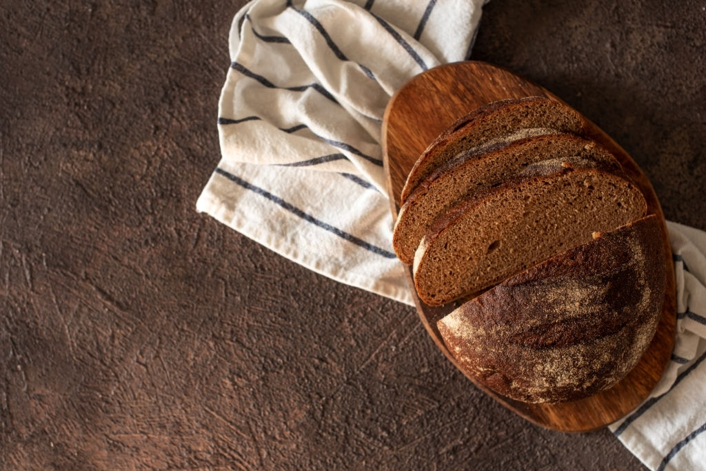 fresh bread and wheat on the wooden.